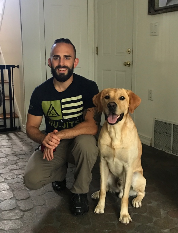 Dog Trainer with Yellow Lab